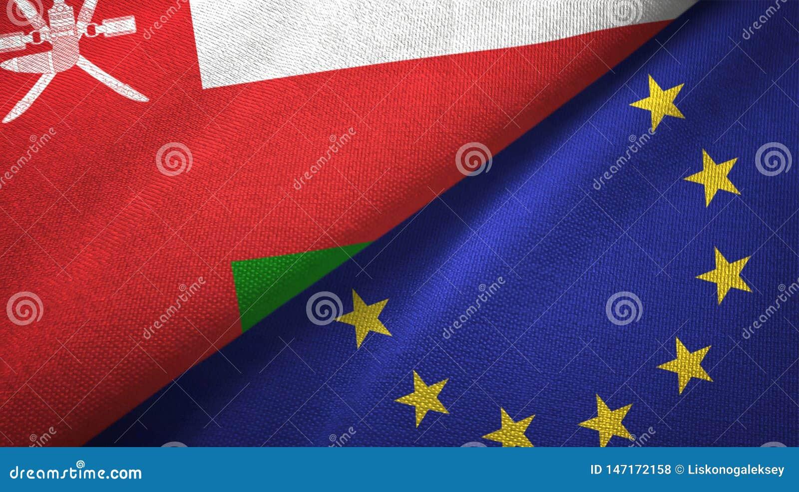 Paño de la materia textil de las banderas de Omán y de la unión europea dos, textura de la tela