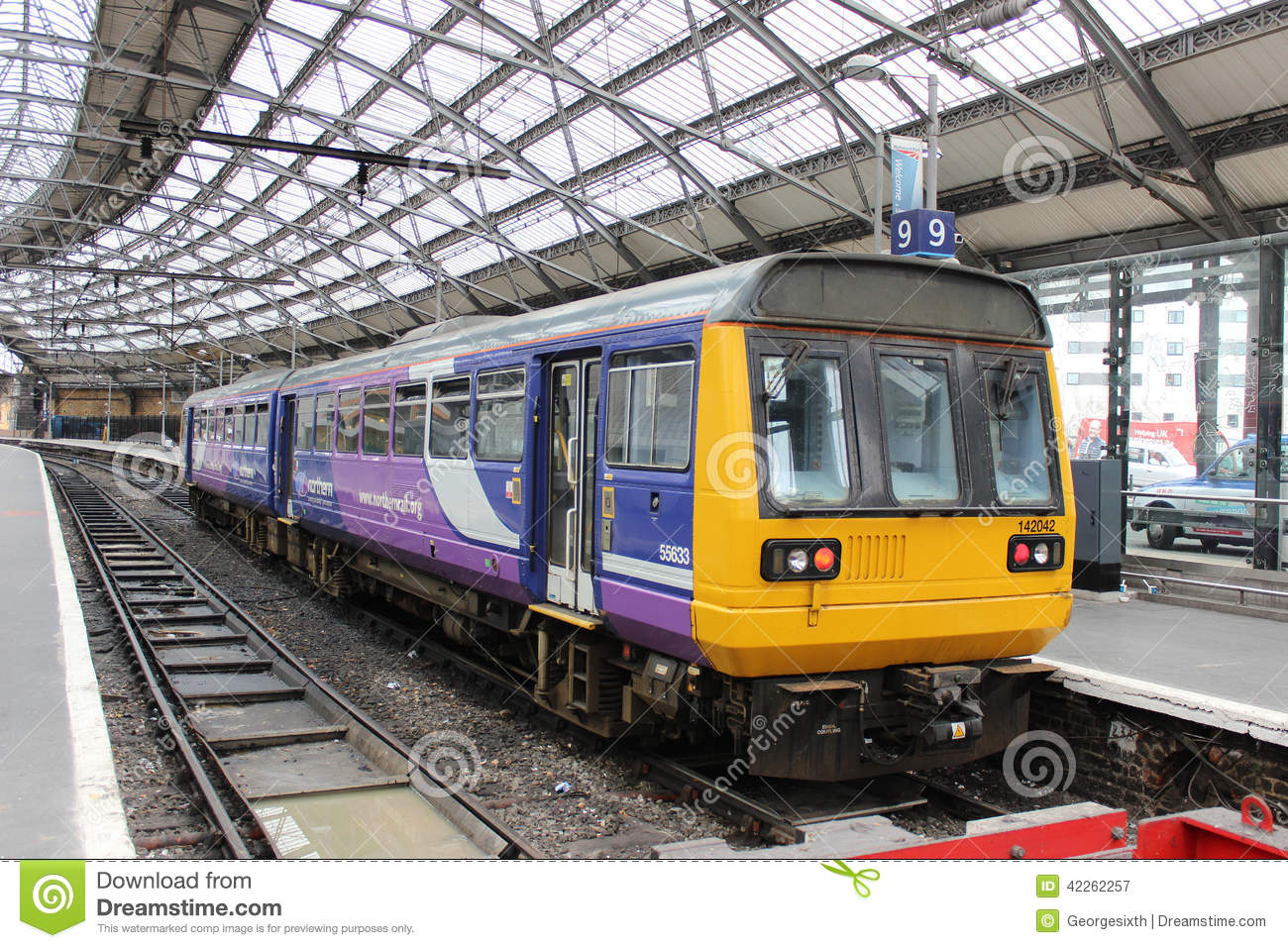 Class 142 Diesel Multiple Unit Train At Platform 9 In Liverpool Lime Street Railway Station Under The Curved Roof Of