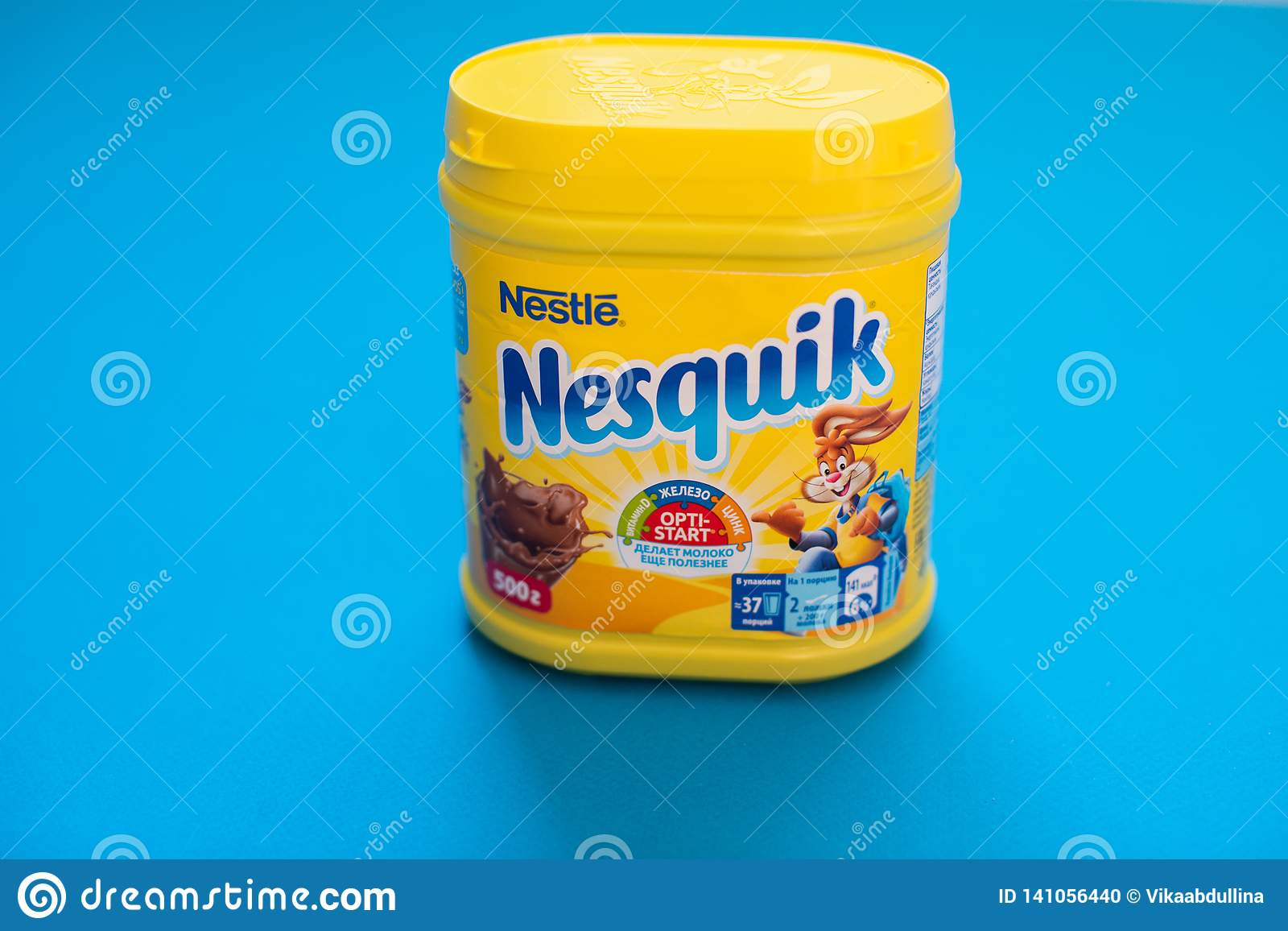 Pack of chocolate and cacao drink Nesquik by Nestle on blue background