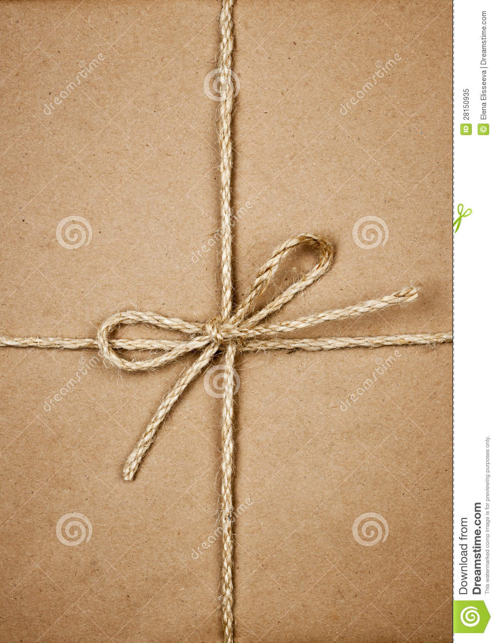 Package In Brown Paper Tied With String Stock Image