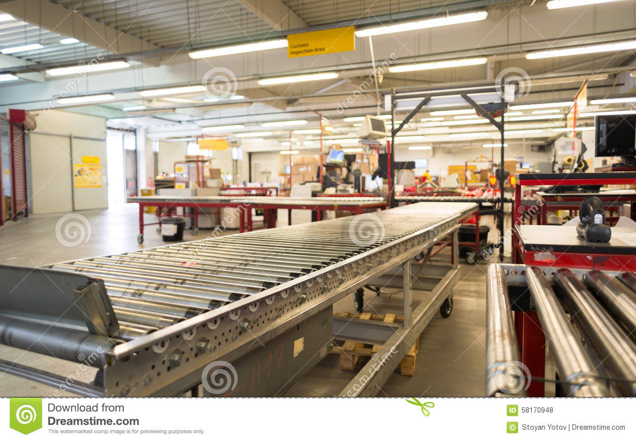 package conveyor belt for distributing packages in dhl storehous editorial stock photo image. Black Bedroom Furniture Sets. Home Design Ideas