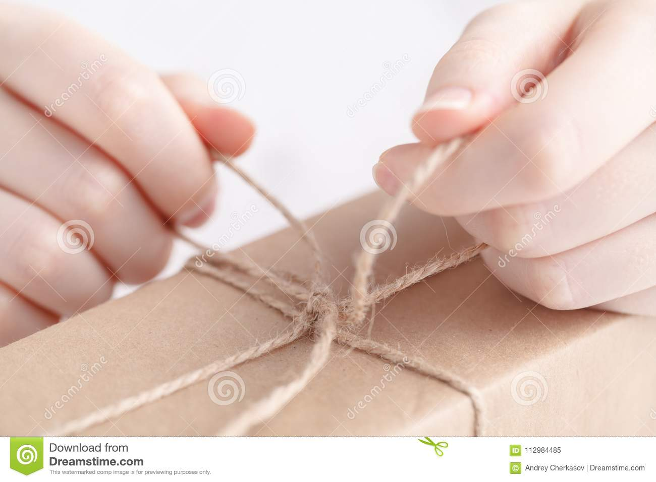 Packing gift in craft papper with twine