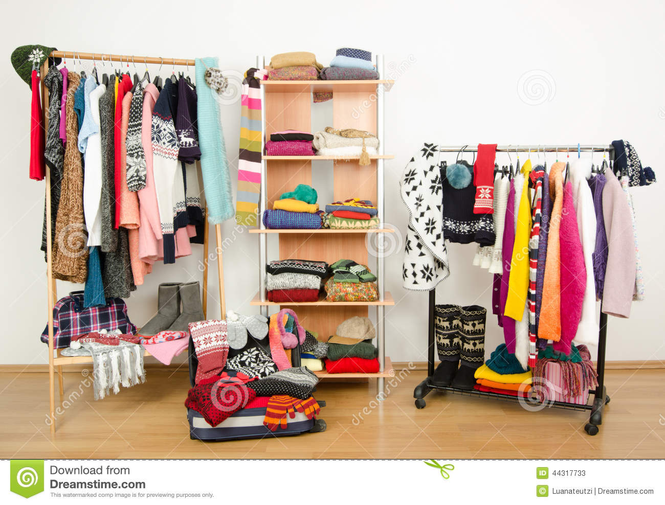 Packing The Suitcase For Winter Vacation. Wardrobe With ...
