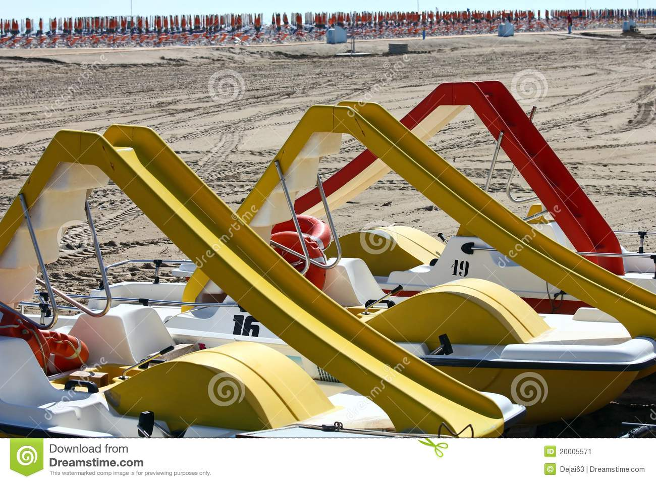 Paddle-boats with slides on it at the beach.