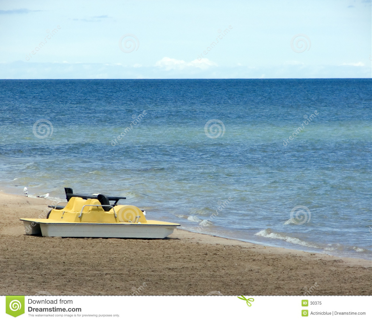 Paddle boat and table on the beach.