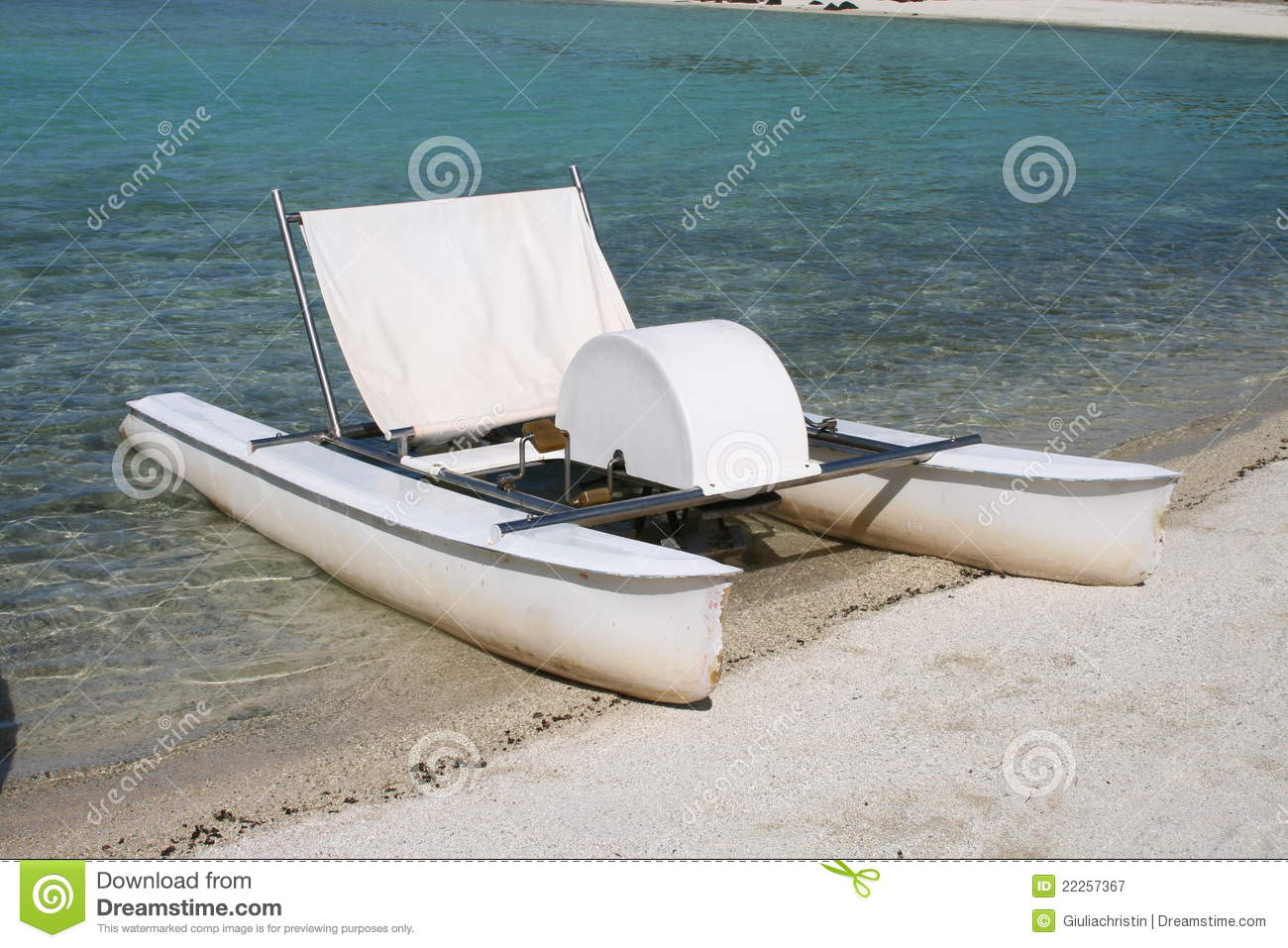 Paddle boat on the beach