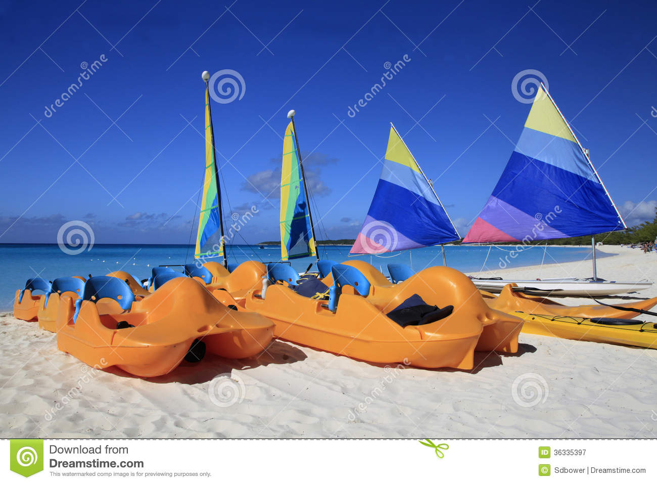 Paddle Boats And Sail Boats On The Beach Of A Cari Stock ...