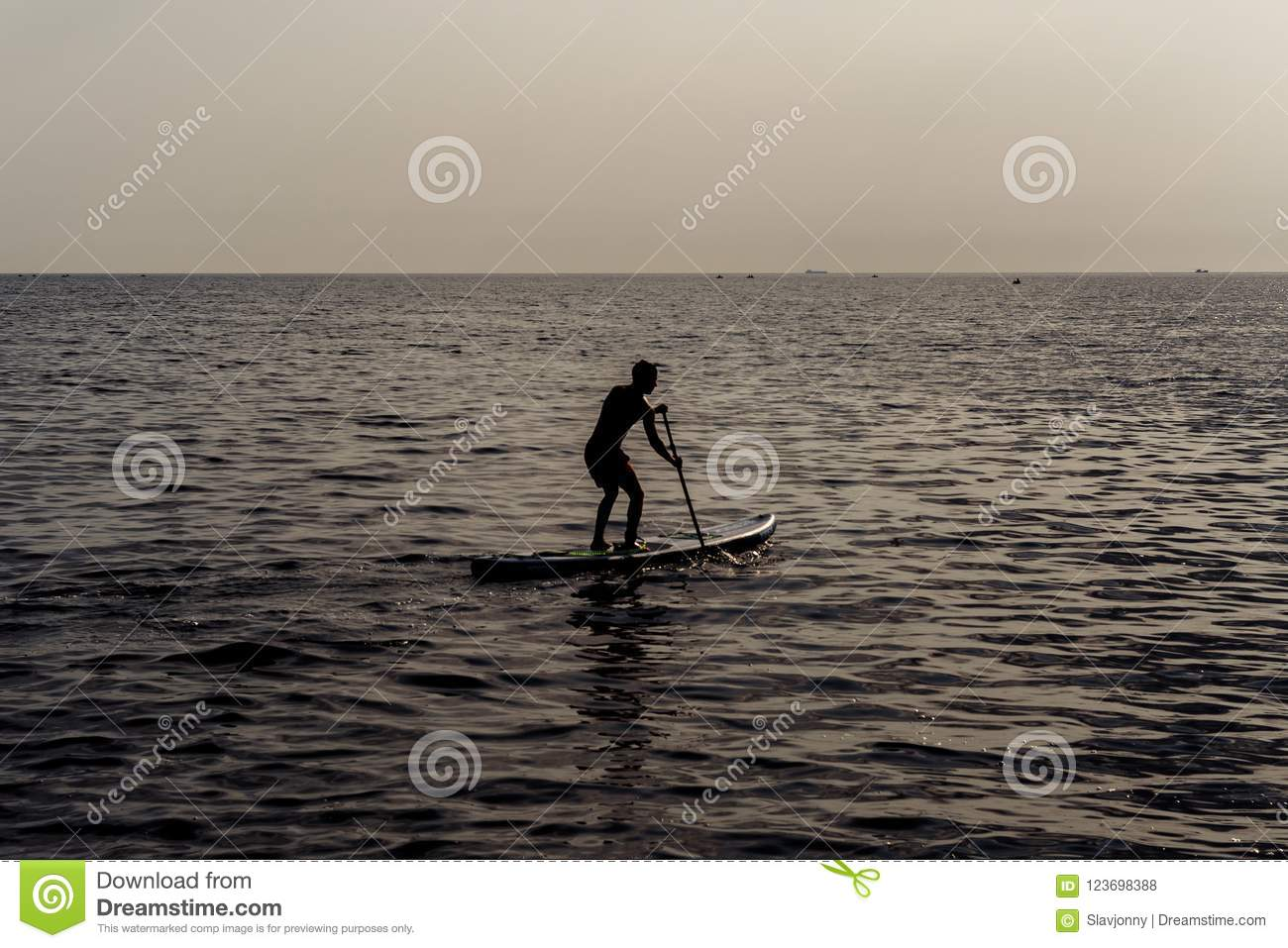 Paddle Standing, Silhouette Of Man On The Beach At Sunset. SUP ...
