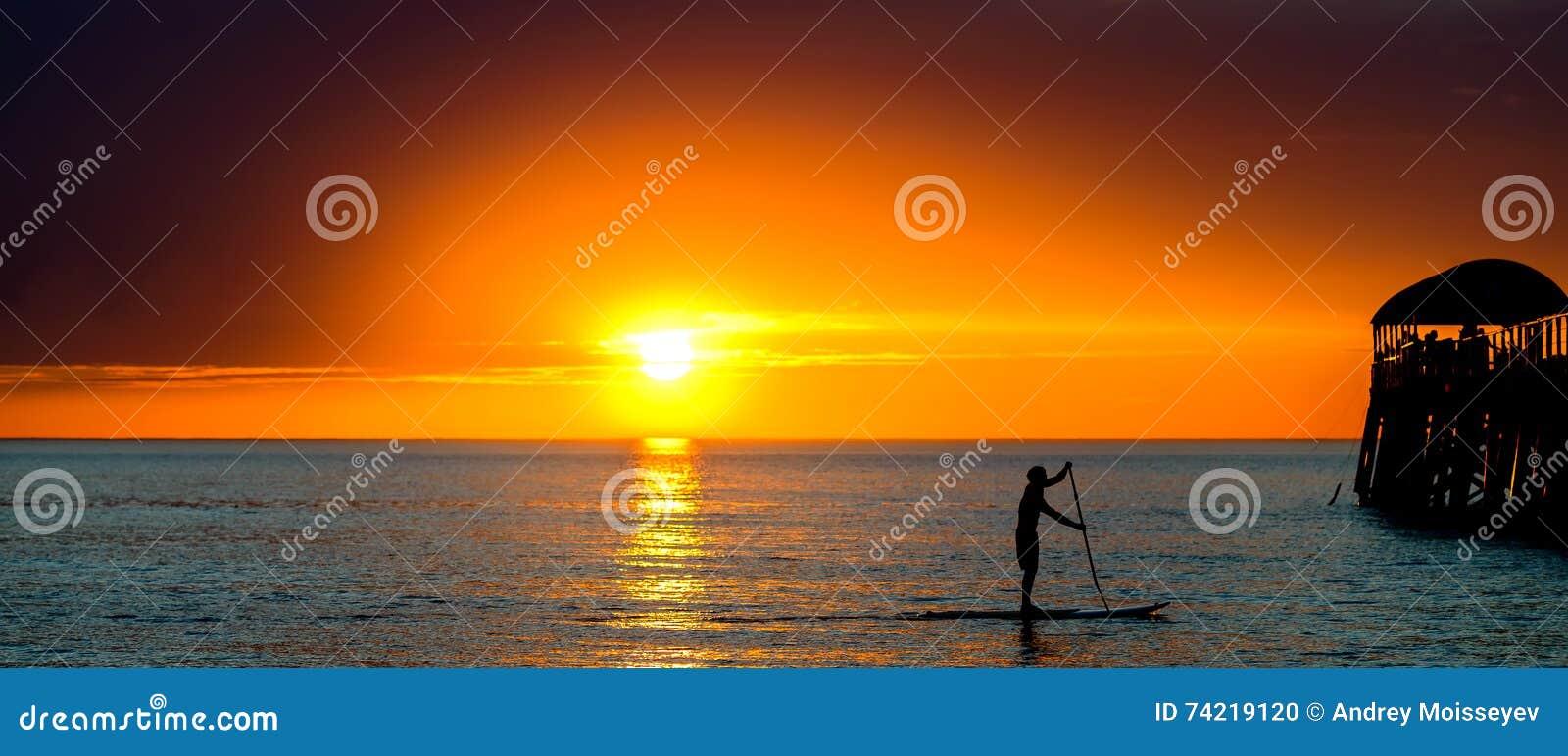 Paddle surfing man