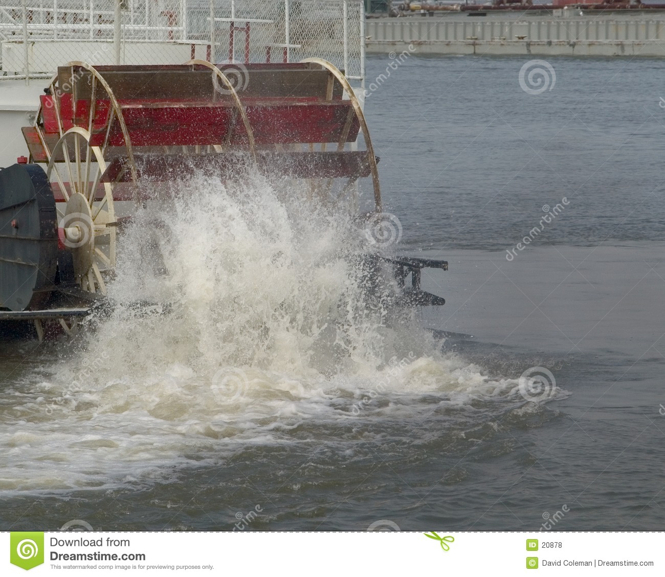 paddle wheeler on the Ohio River churns the water while driving the ...
