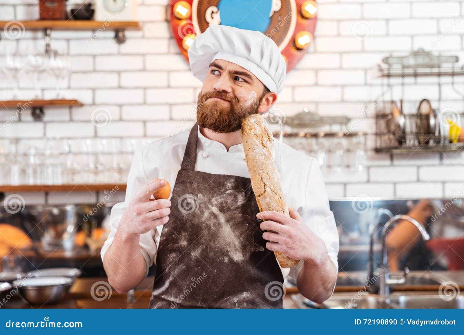 Padeiro farpado pensativo que guarda ovos e pão na cozinha