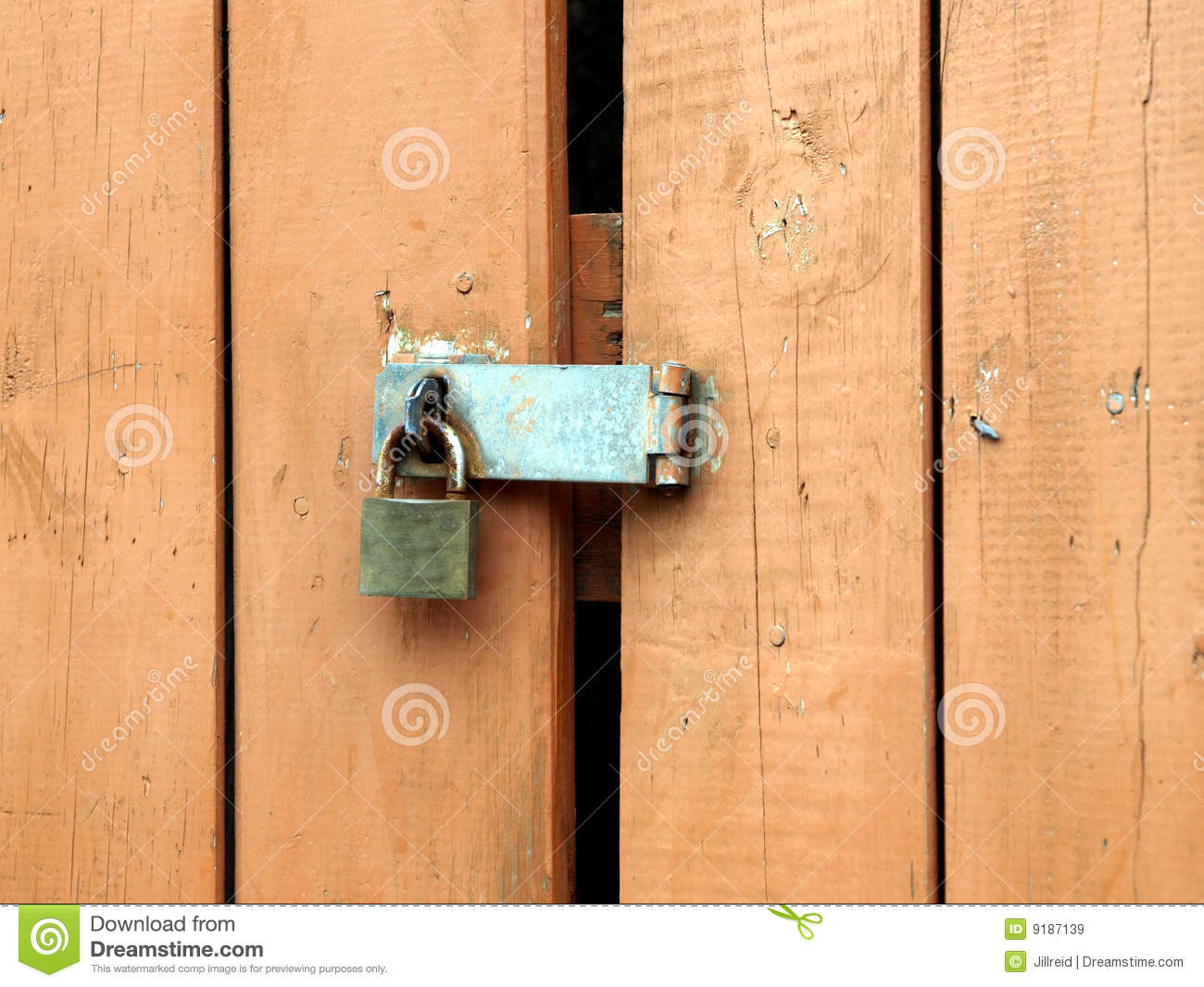 Padlock Hasp On Weathered Painted Door Royalty Free Stock