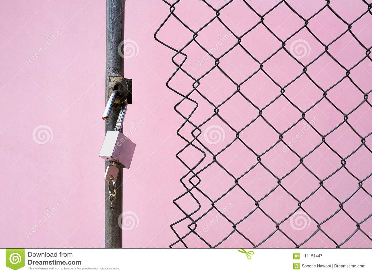 A Padlock And Key At The Wired Gate Stock Image Of Metal Buildings