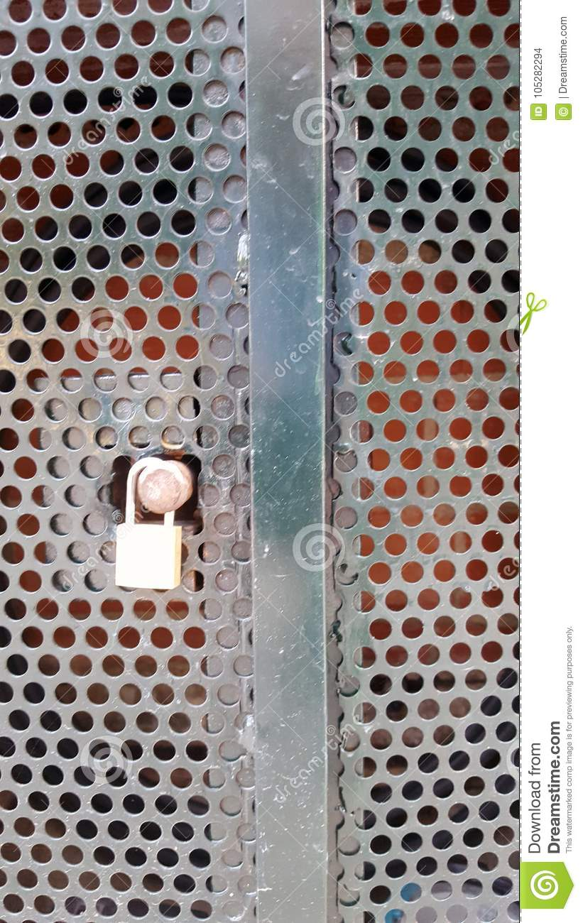 Padlocked Metal Cupboard With Round Cutout Holes. Stock Photo ...