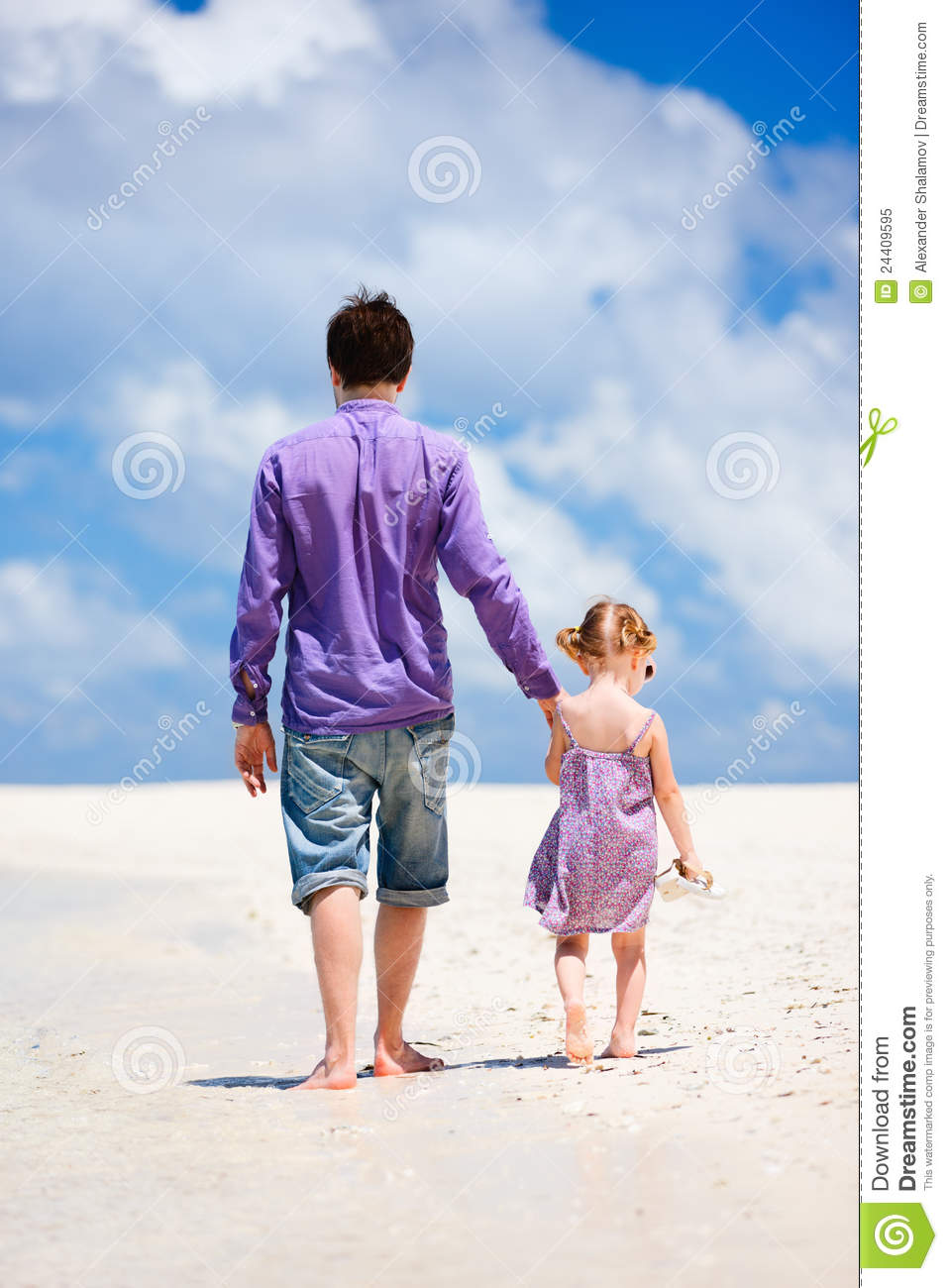 Father and Daughter Walking at the Beach