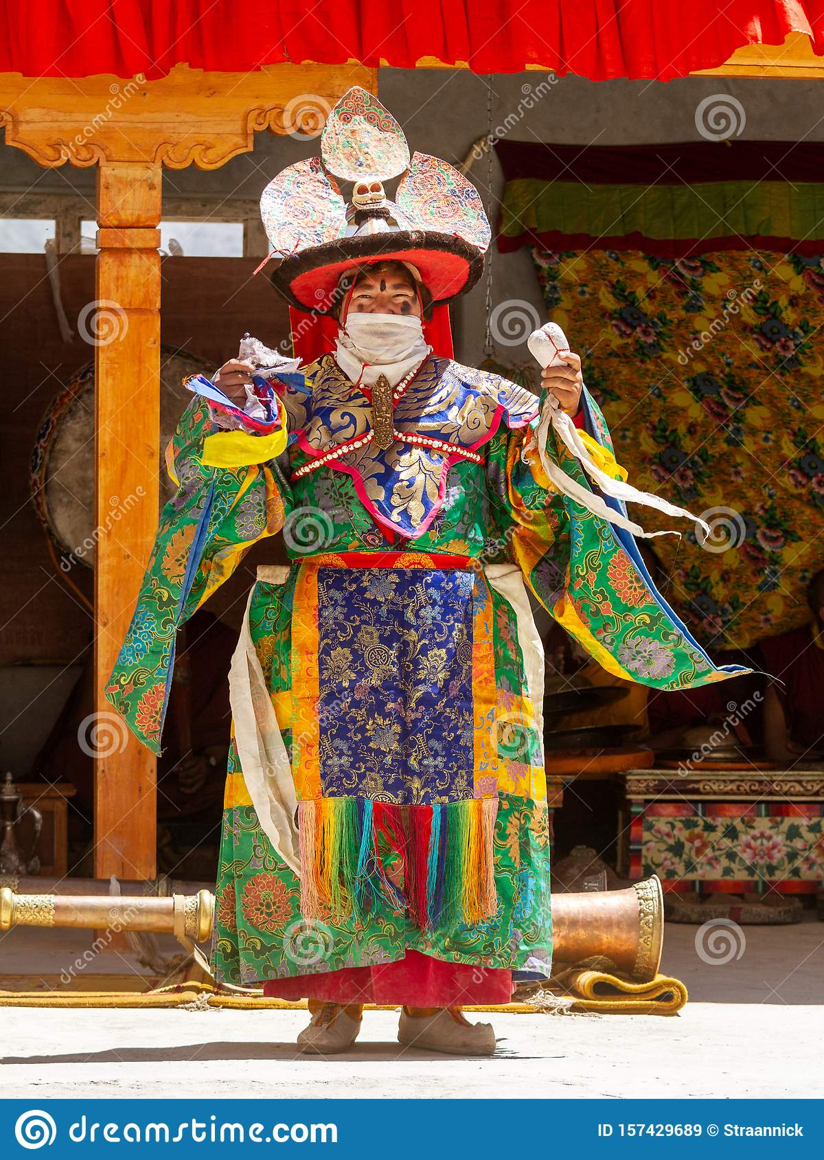 Lama in ritual costume and ornate hat performs a historical mystery Black Hat Dance of Tibetan Buddhism on the Cham Dance Festival
