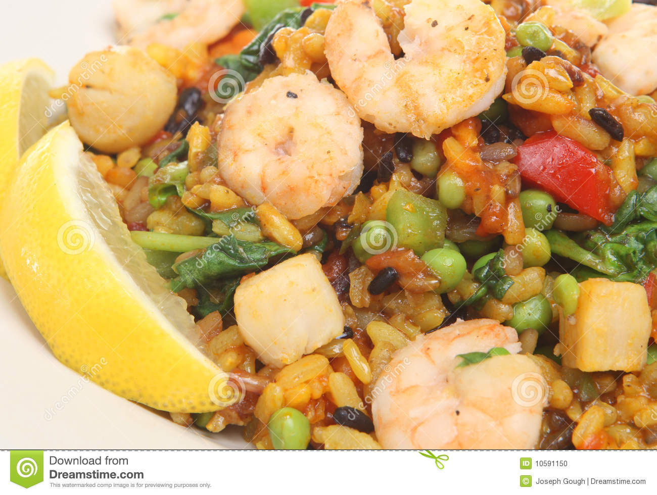 Paella with king prawns and scallops.