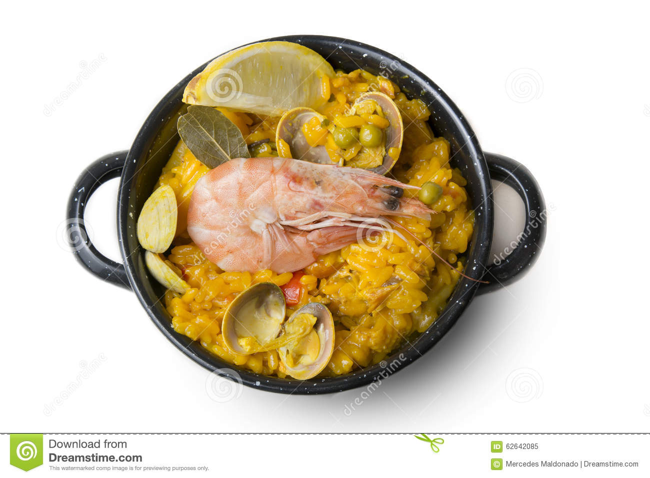Paella small, typical Spanish rice with seafood in individual po