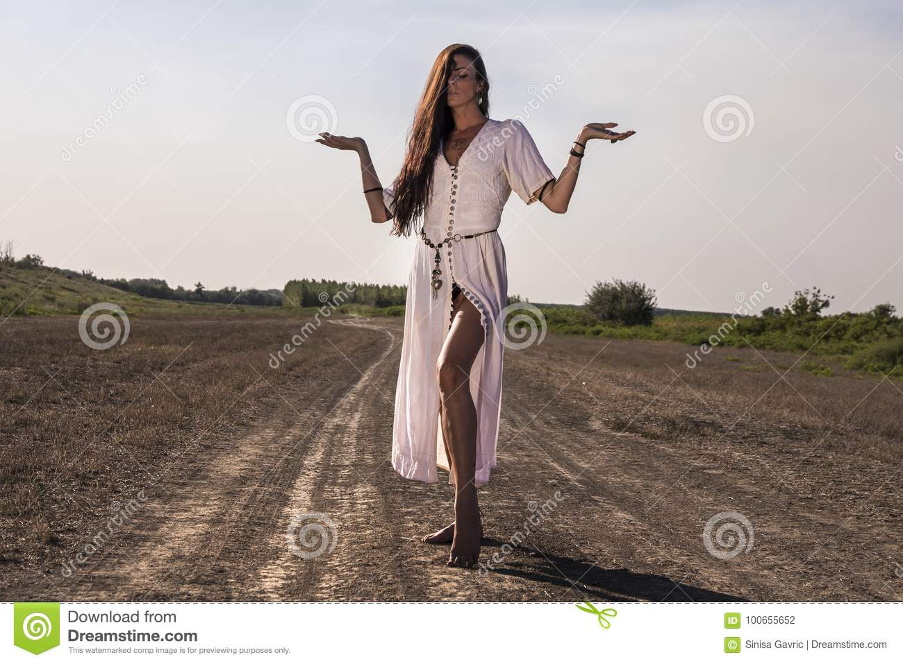Woman on the dirty road posing