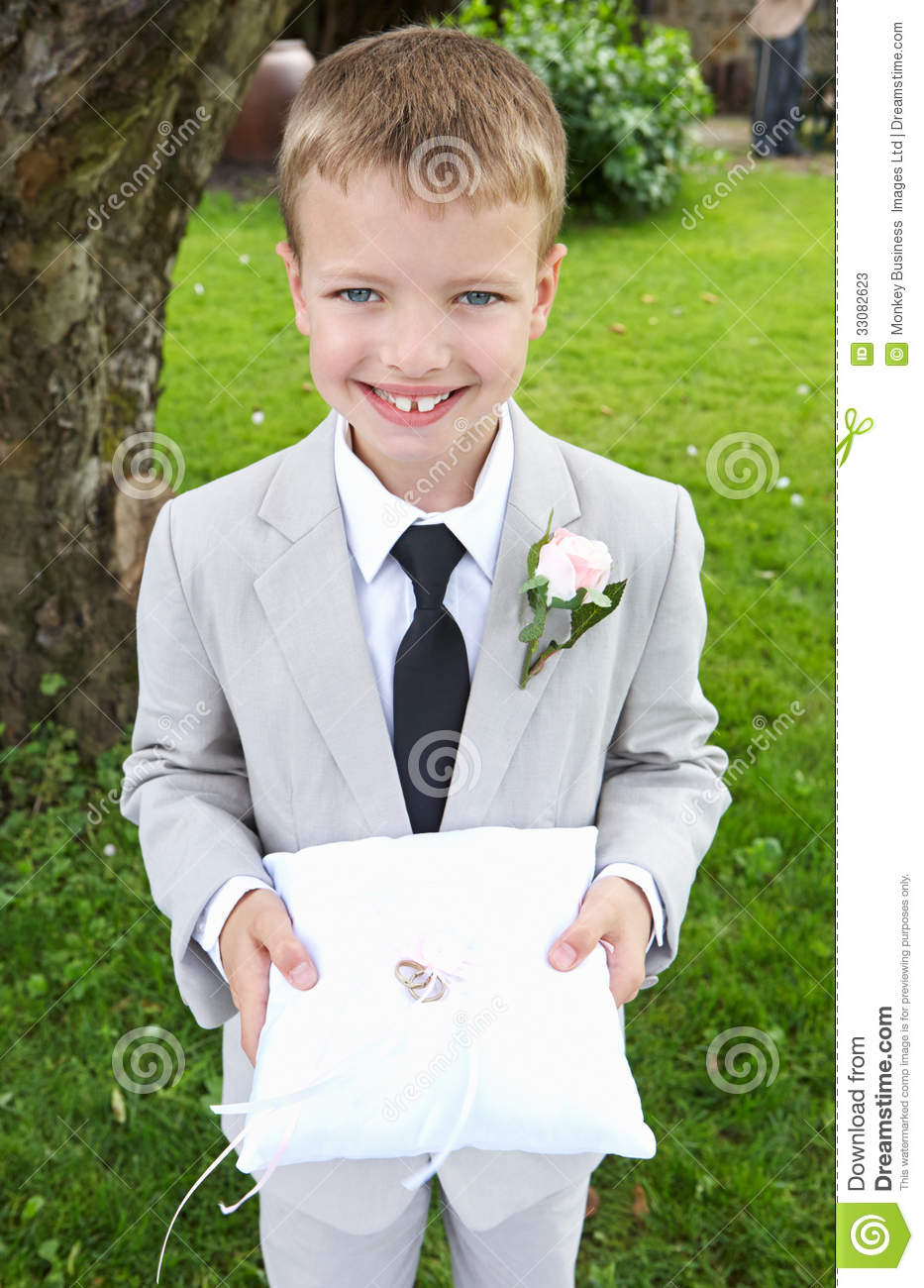 Page Boy Carrying Wedding Ring On Cushion Stock Photos - Image ...