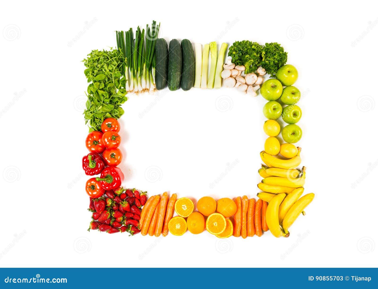 Pagina fatta dalla frutta e dalle verdure isolate su bianco
