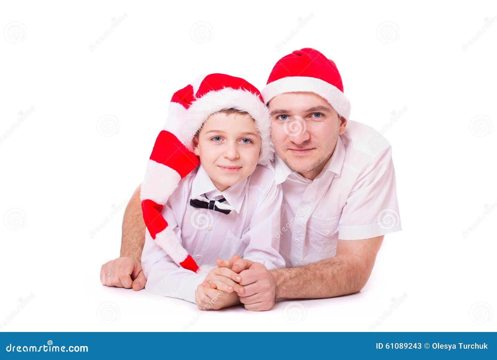 Pai e filho nos chapéus de Santa
