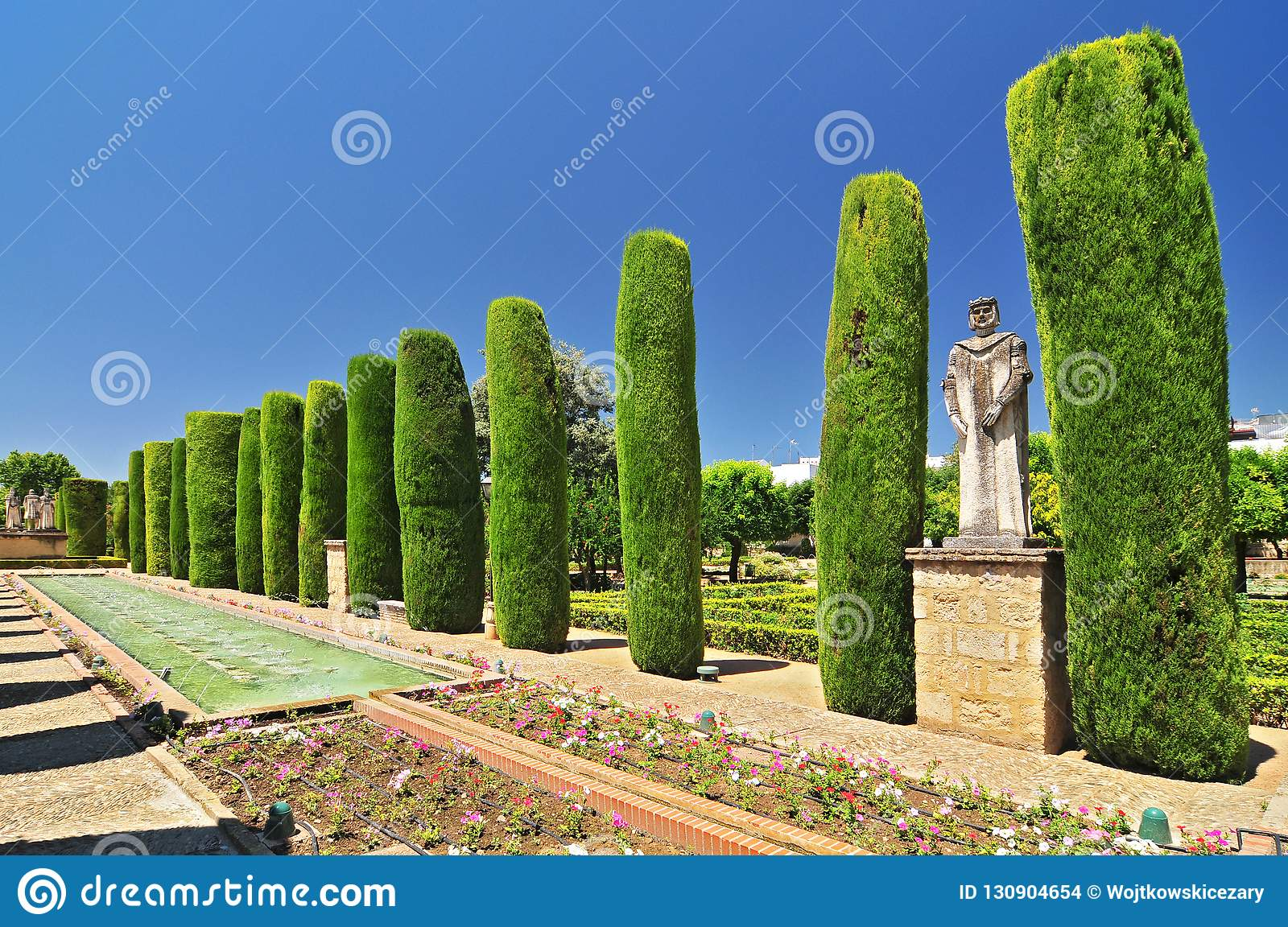 Pain Andalusia Cordoba, Alcazar of the christian kings cypress alley and basins in the gardens, Spain.