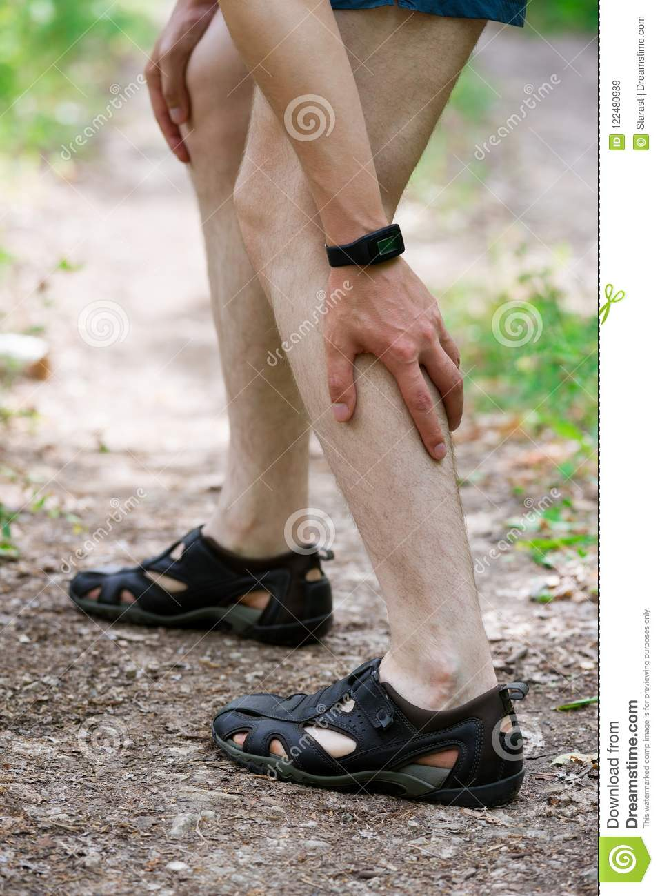 pain in calf muscle sprains on the leg massage of male foot