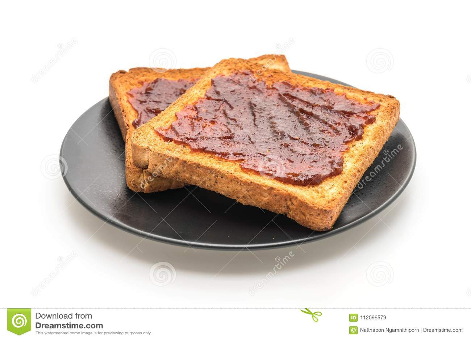 Pain grillé de pain de blé entier avec la pâte de piment