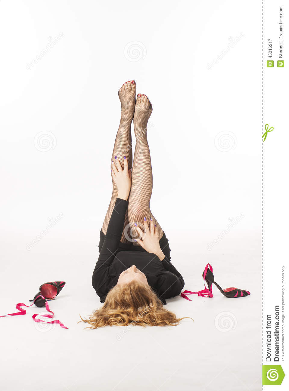 Pain In The Legs After Walking In High Heels Stock Photo