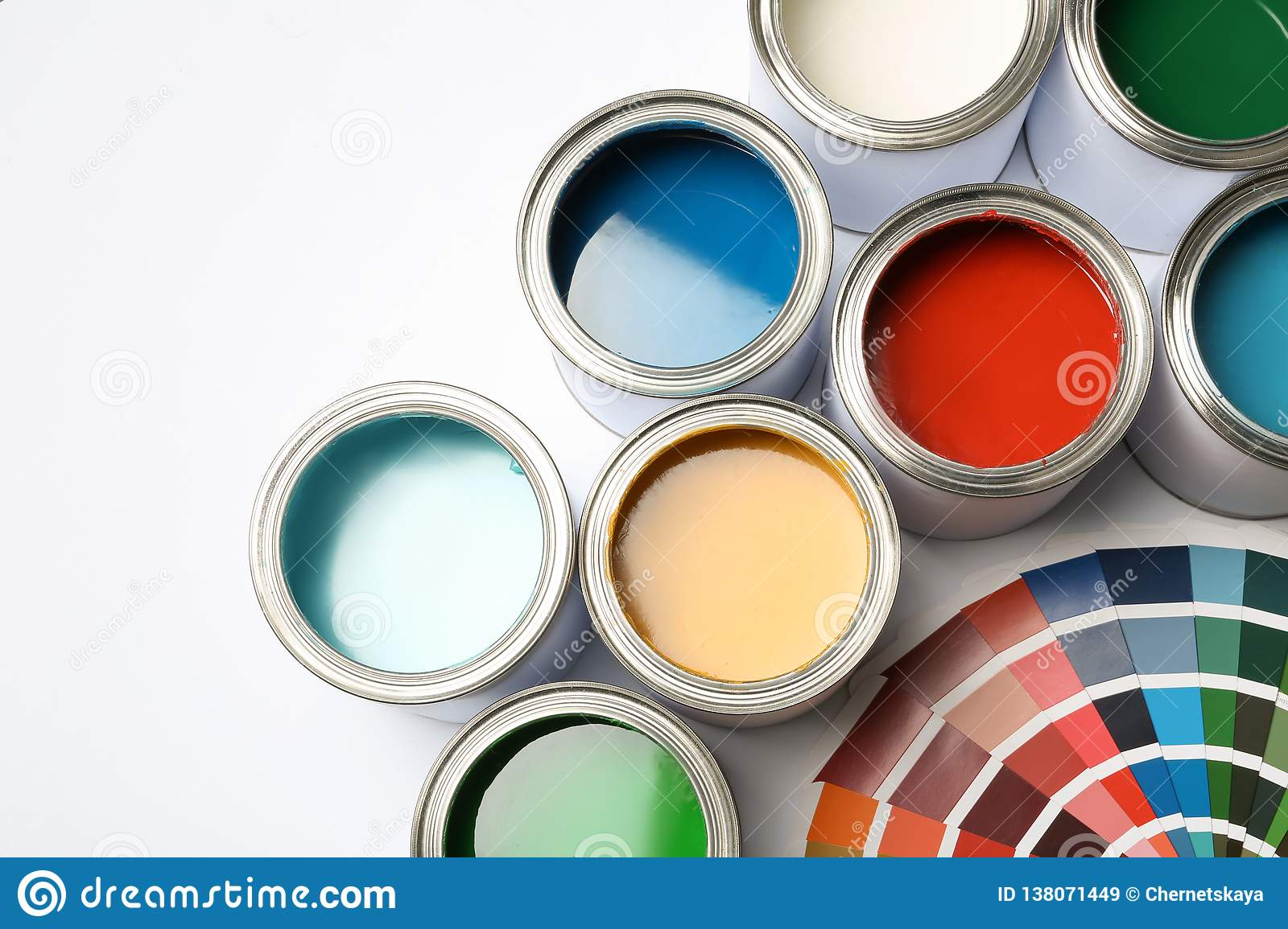 Paint cans and color palette on white background