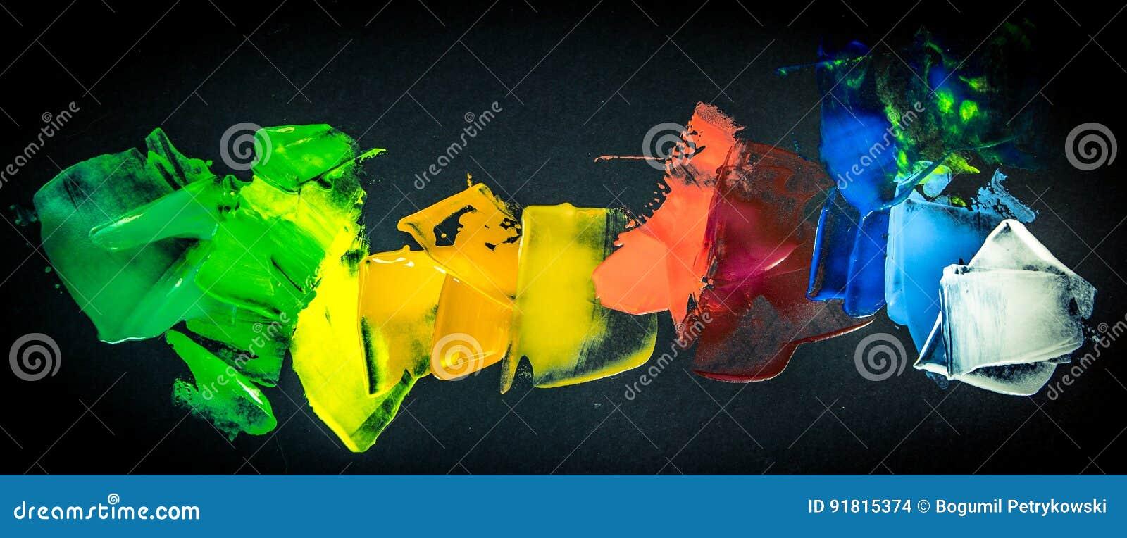 Paint color palette on black background