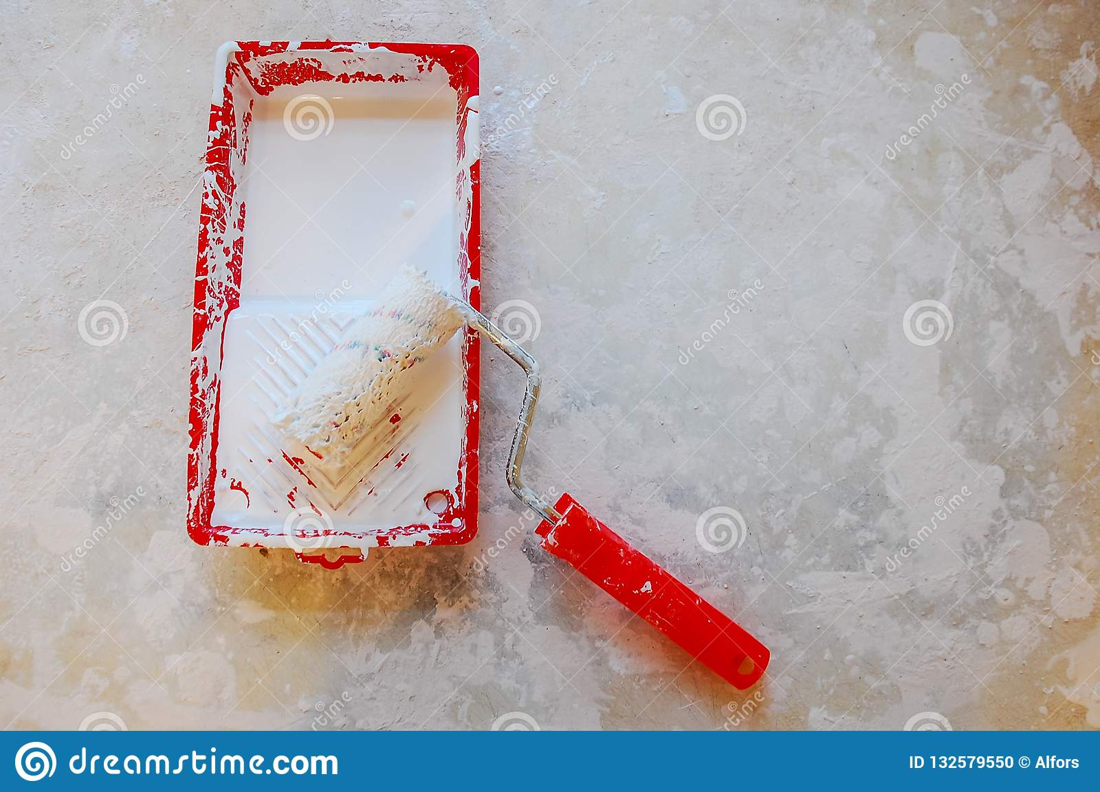 Paint roller in tray. white paint