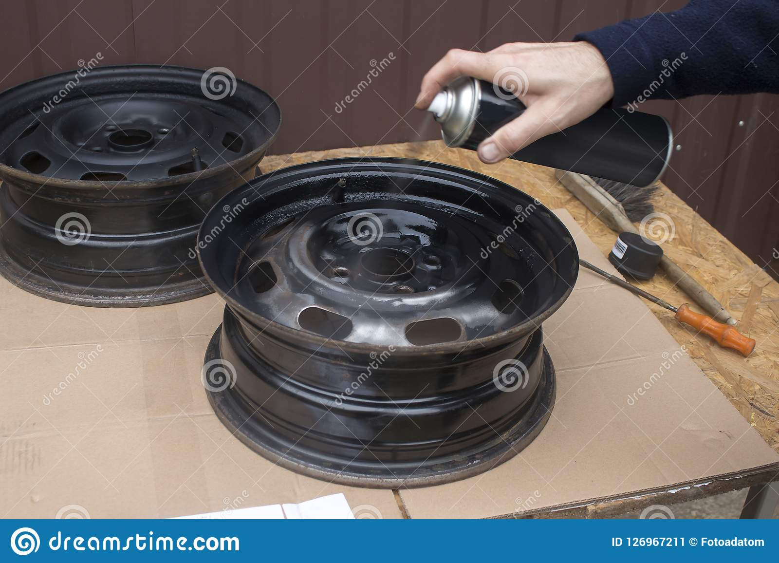 7  Paint The Steel Car Wheel In Black With Spray Paint