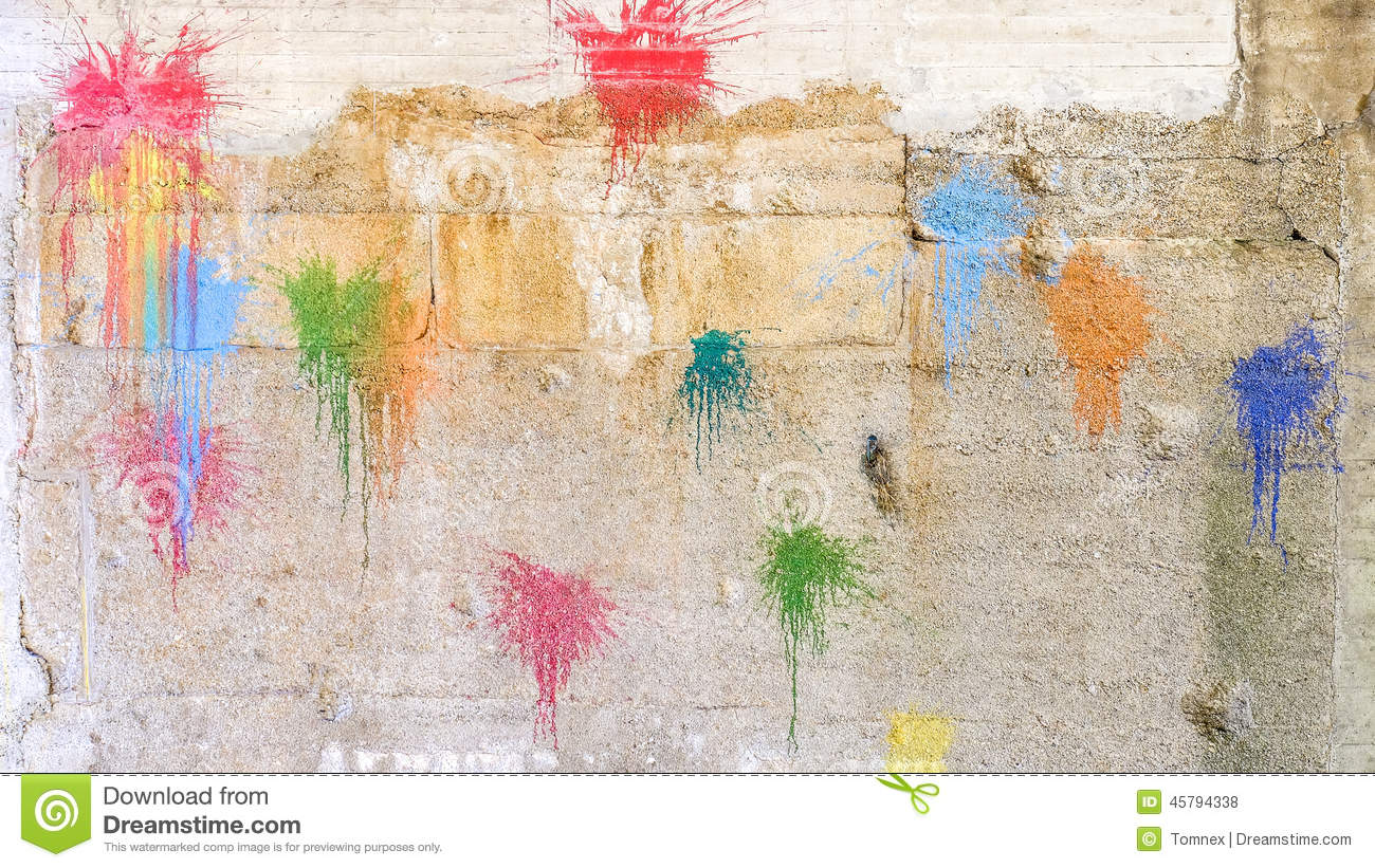 Paintball background. Colorful paintball splats on a concrete wall for your colors, abstract backgrounds