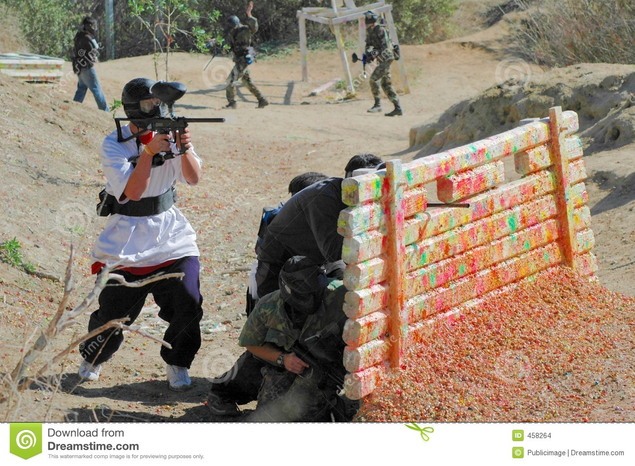 Download Paintball Players Behind Bunker Stock Photo - Image of bunker, fighter: 458264