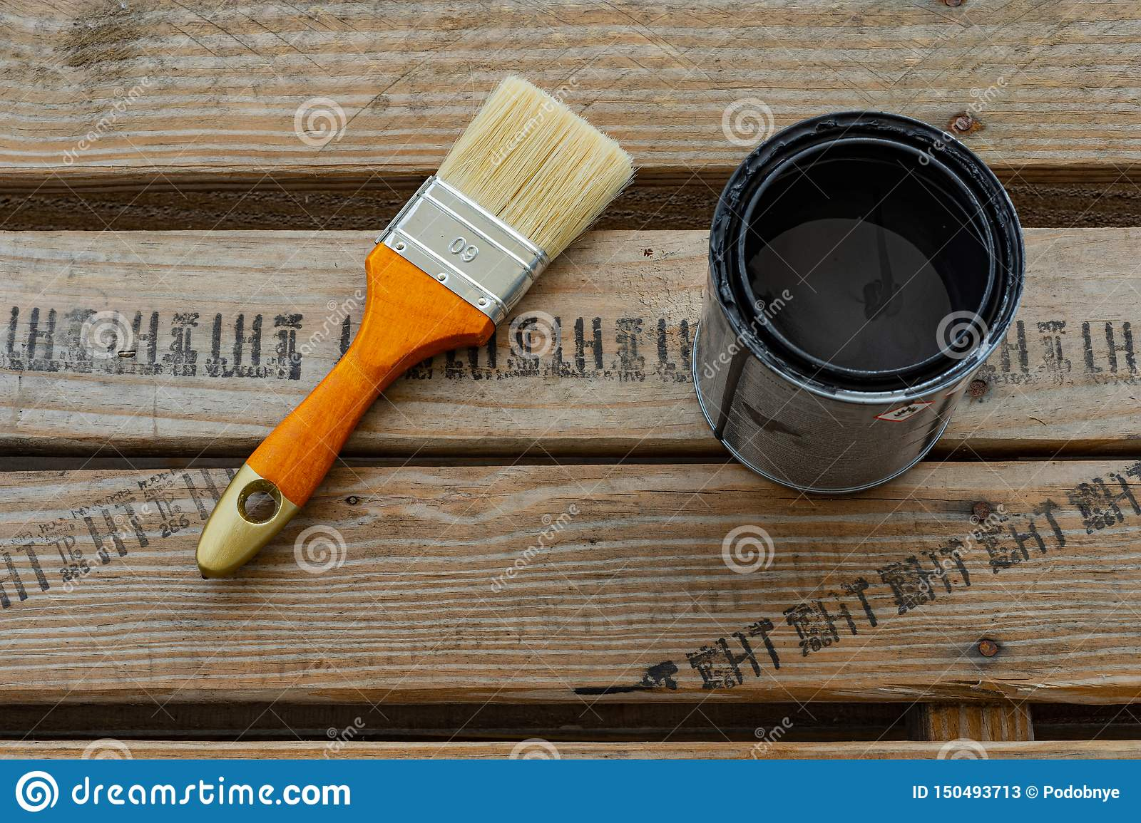 Paintbrush and can with color for home renovation