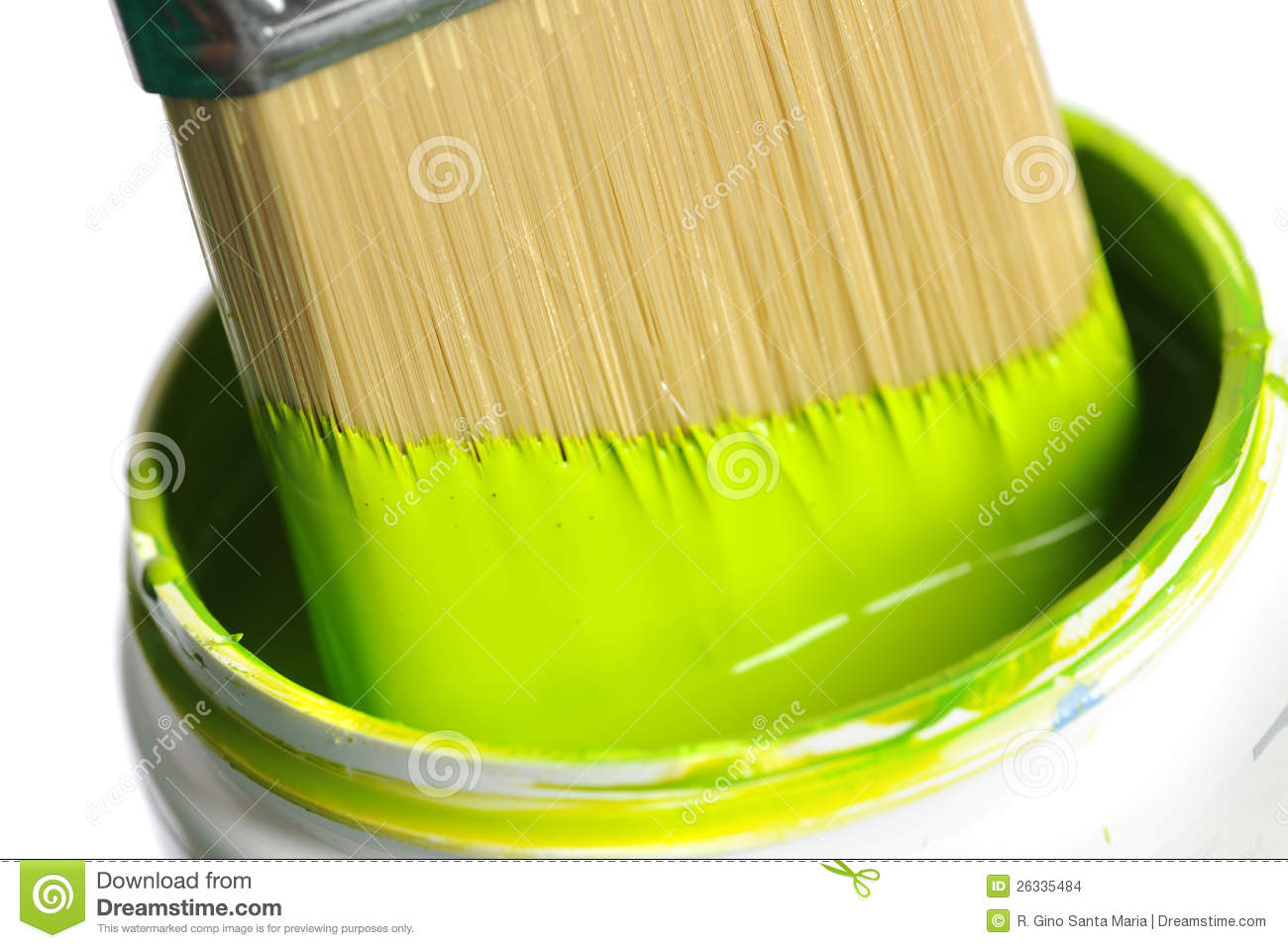 Paintbrush Dipping Into Can Of Green Paint Stock ImagesImage