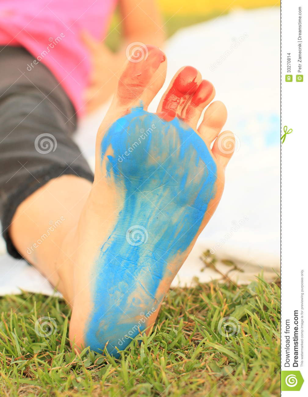 Painted bare foot of a little kid - girl
