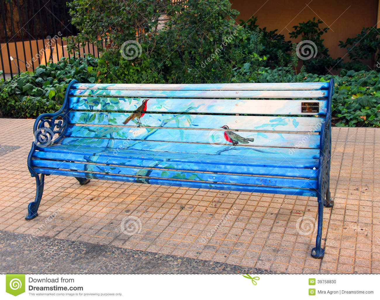 ... who painted 40 park benches in a neighborhoodof Santiago, Chile