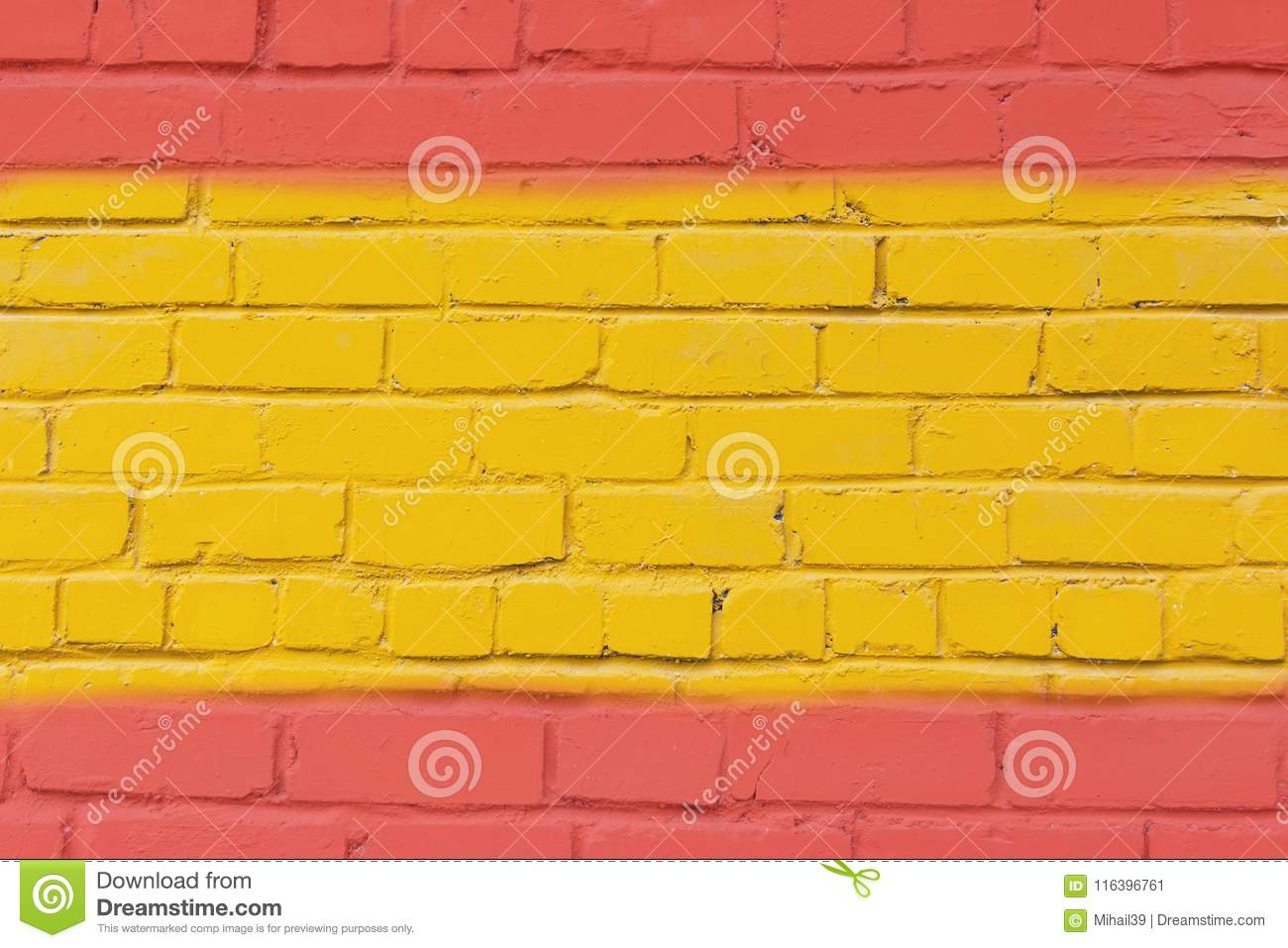 Painted Brick Wall In The Colors Of The Flag Of Spain. Stock Image ...