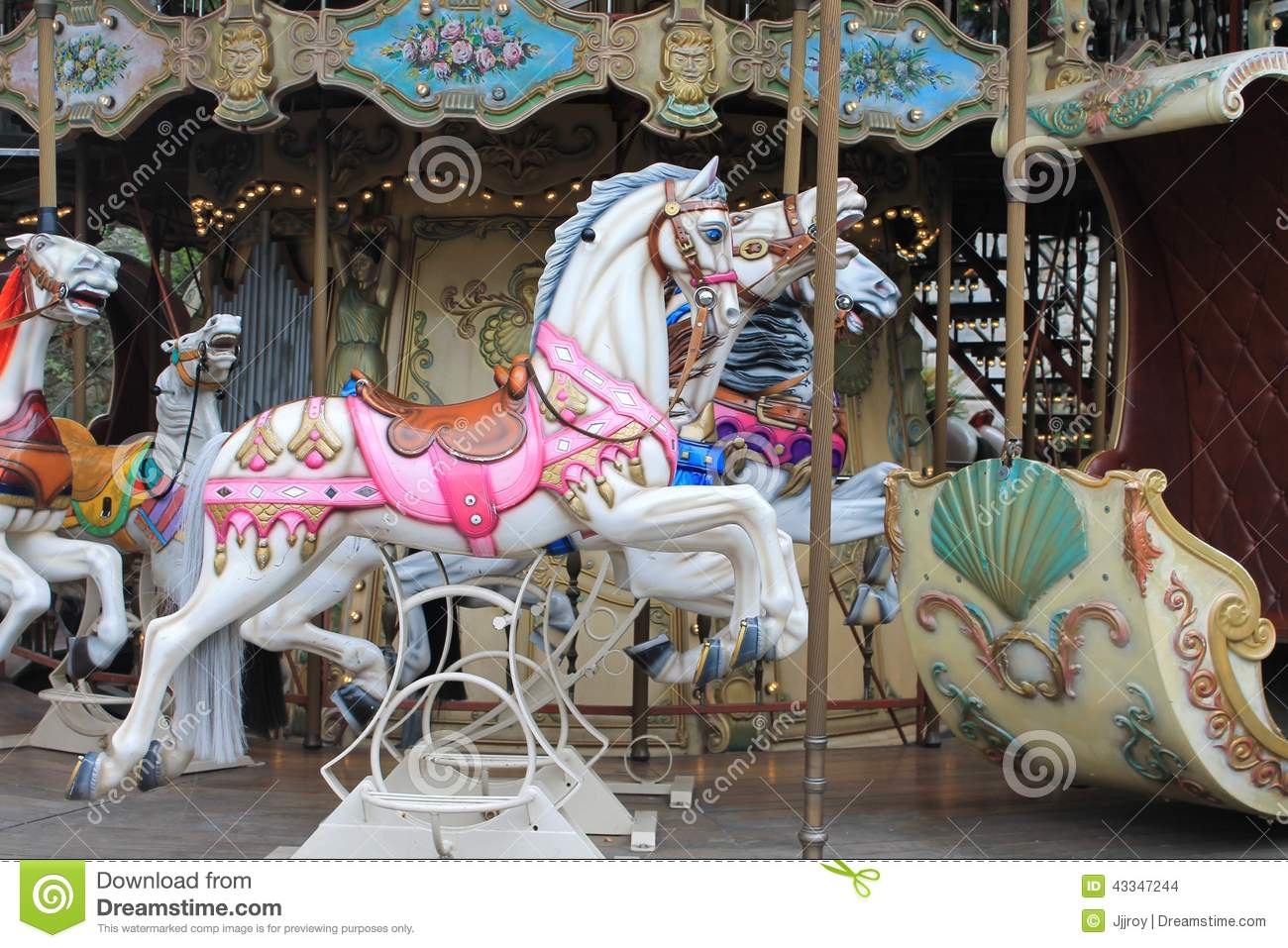 Colorful vintage carousel horses near Sacre Coeur Cathedral, in the ...