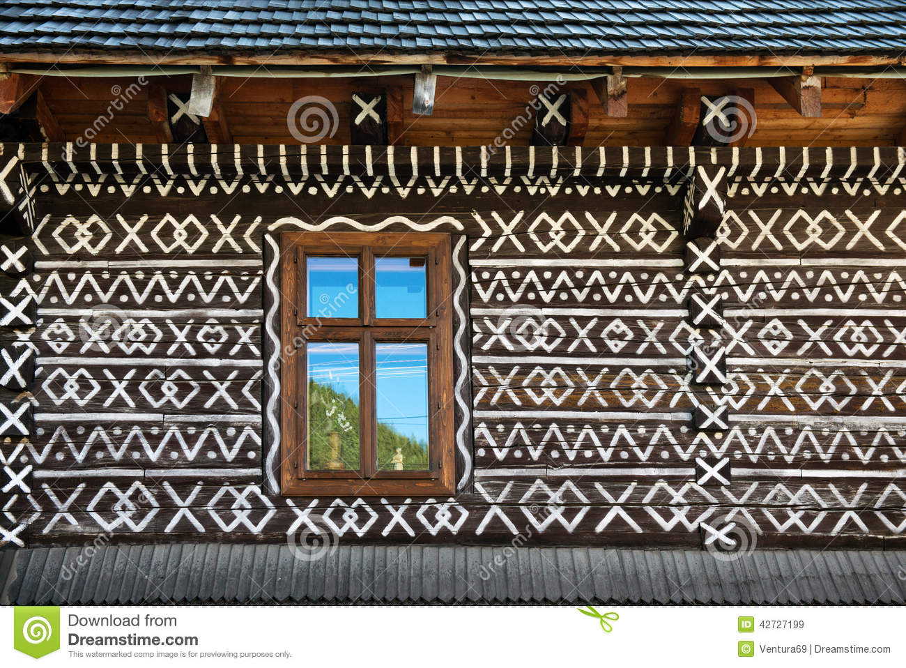 Painted Decorations On Wall Of Log House In Cicmany Slovakia