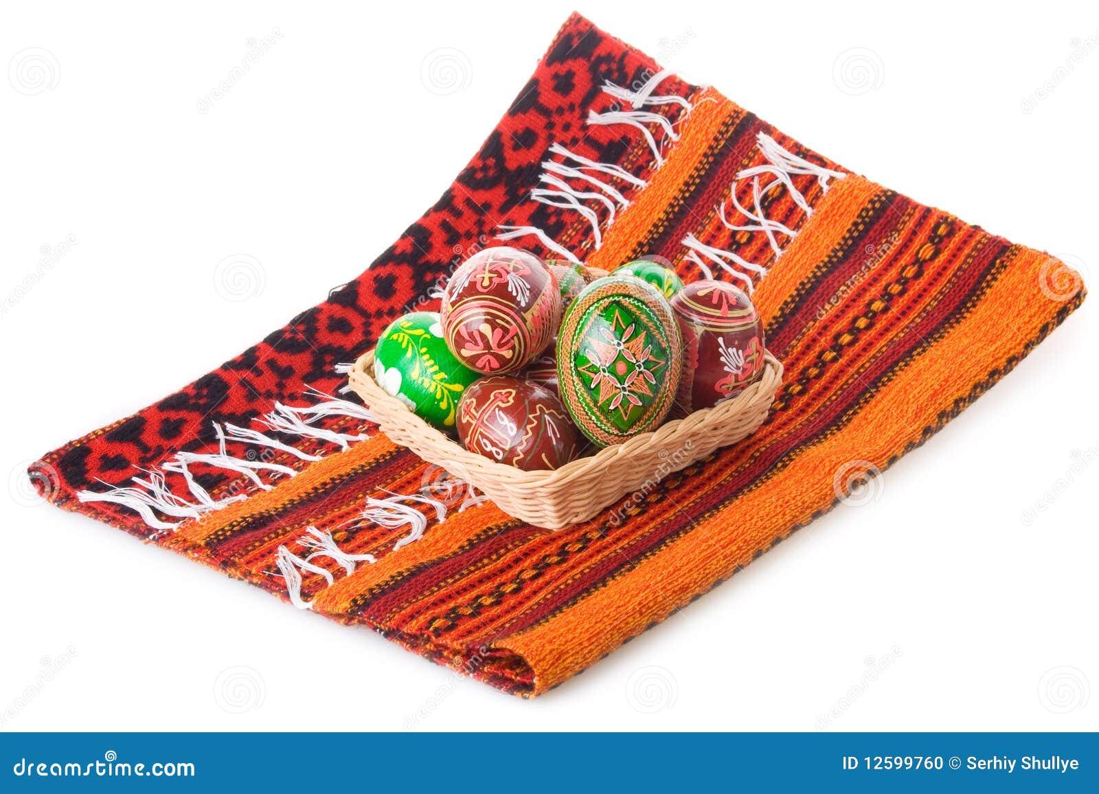 Towel Art Basket : Painted easter eggs in basket on towel stock photo image