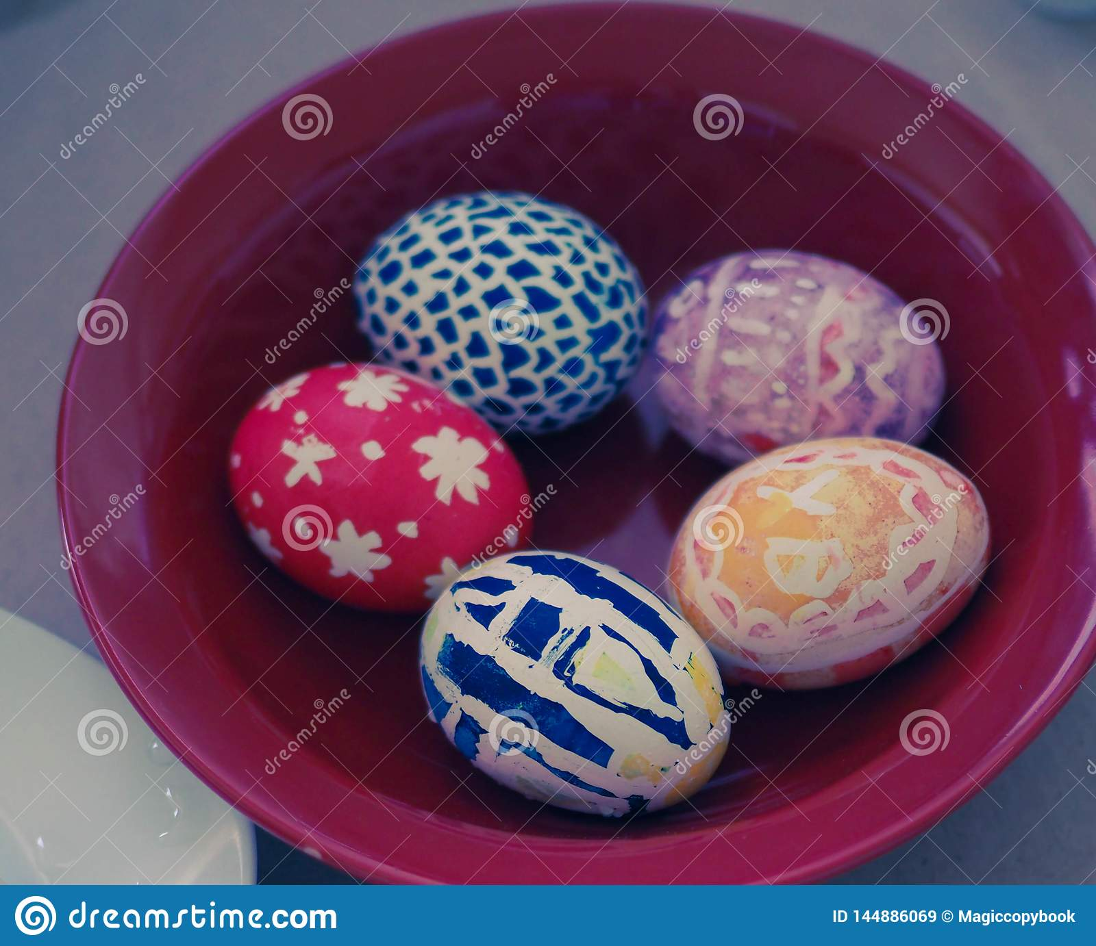 Painted eggs on plate