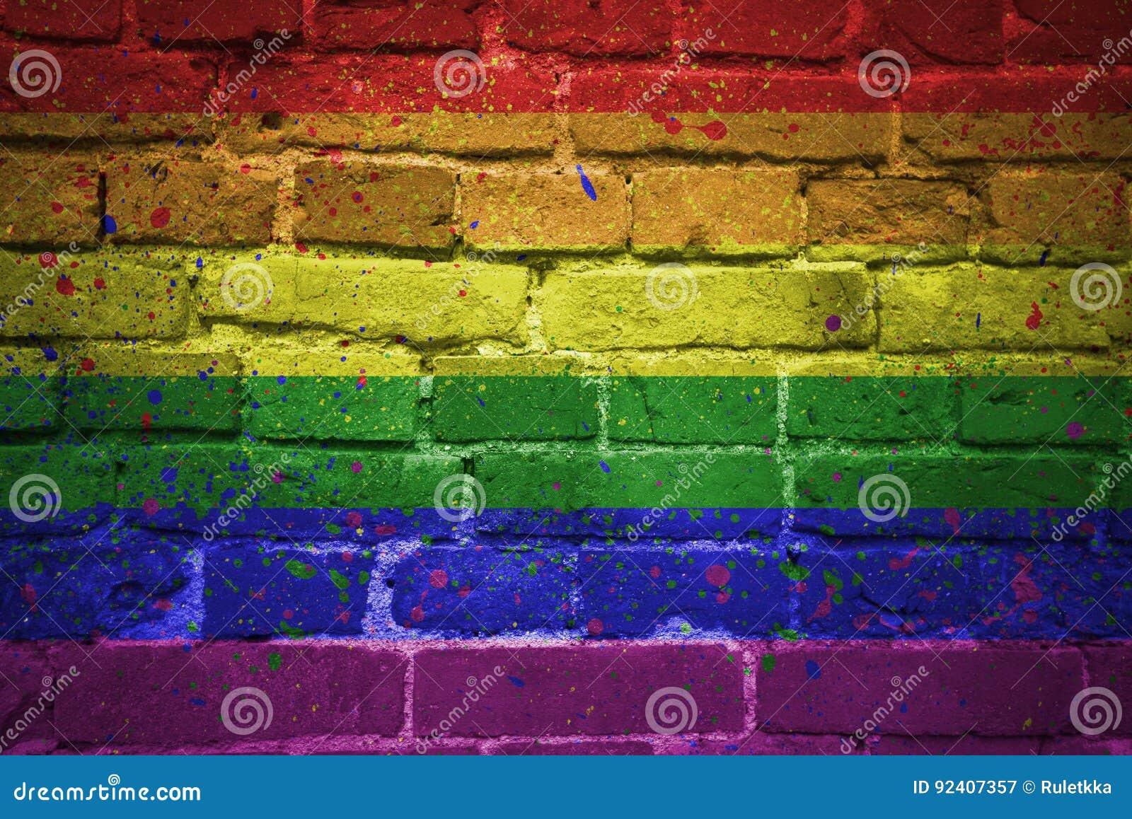 Painted gay pride rainbow flag on a brick wall