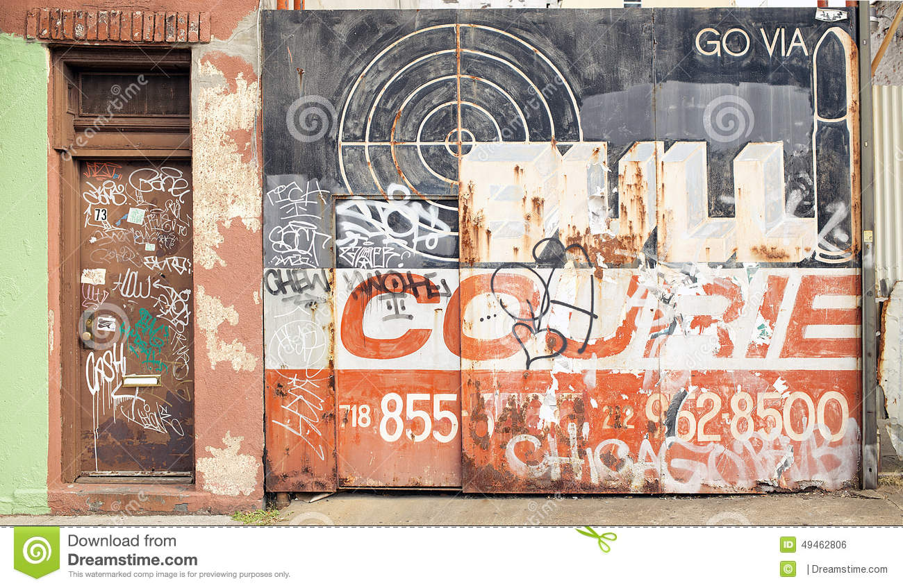 A Painted And Graffitied Garage Door In Dumbo New York City