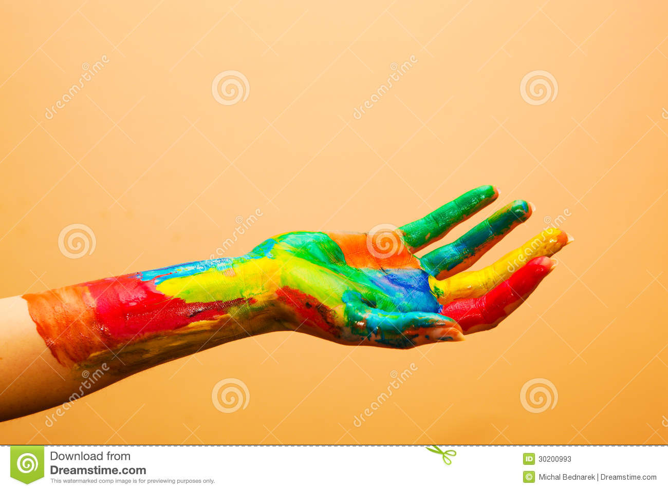 Painted hand, colorful fun. Orange background
