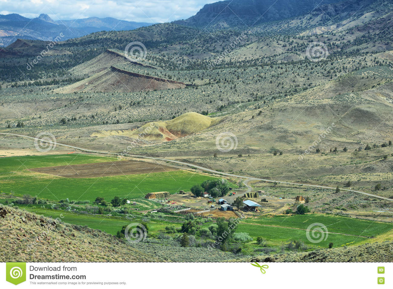 View Of A Ranch And Mountains From Carroll Rim Trail In Painted Hills National Monument Oregon USA