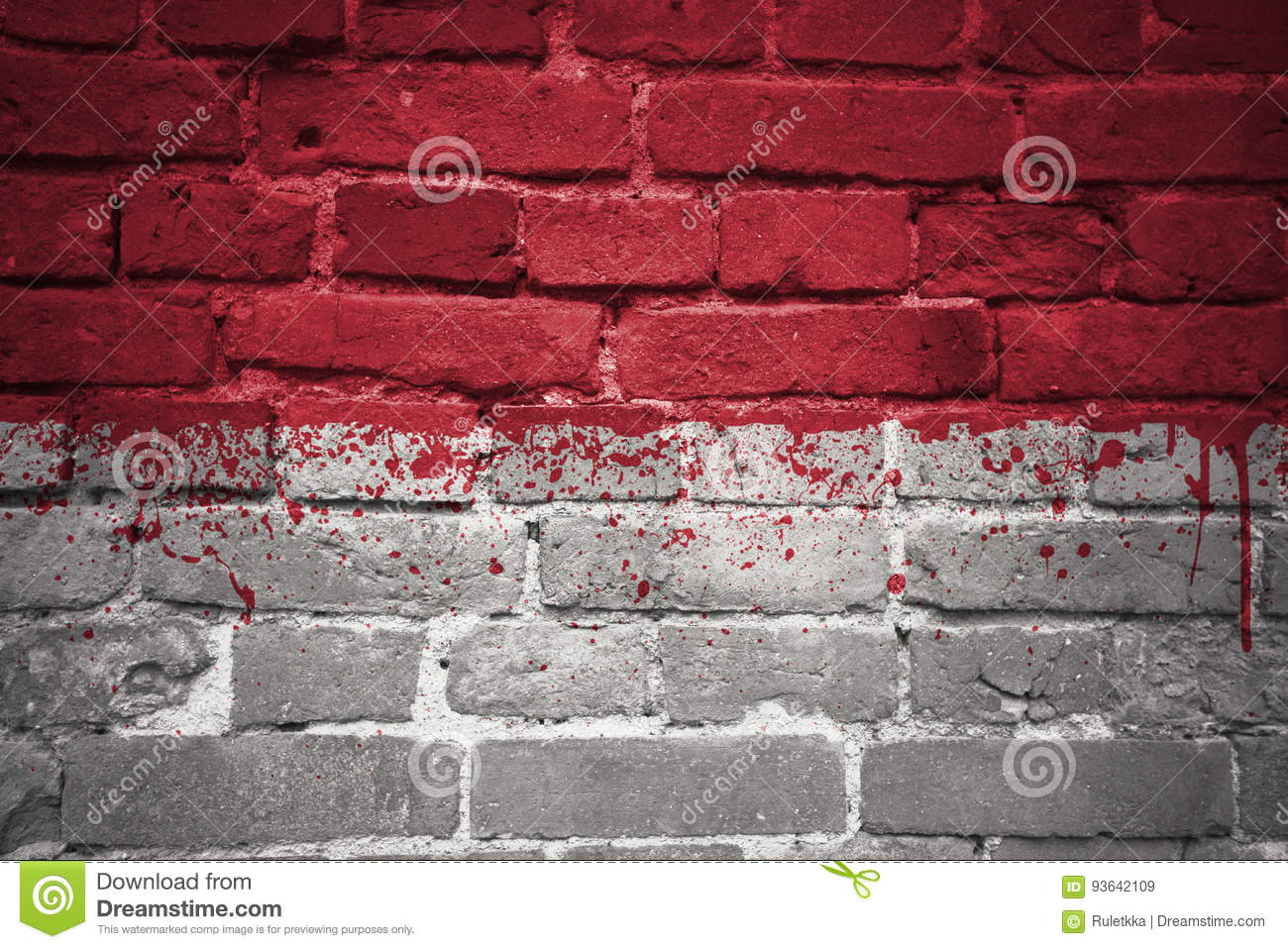 Painted national flag of indonesia on a brick wall
